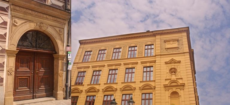 Door and Yellow Building
